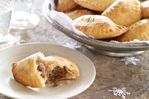 Tourtiere Mini Turnovers - In the old days, cooks baked their pie in a pottery casserole called a tourte.  Over the years, the traditional dish changed to a deep-dish pie plate, but the original name stuck.  For these turnovers, we skip the dish altogether!  #appetizers