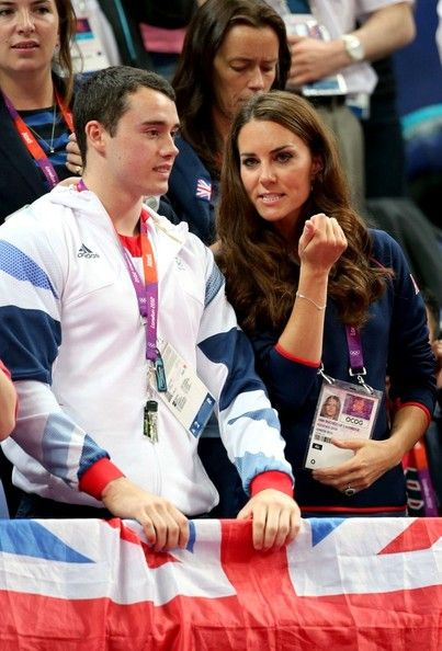 Catherine, Duchess of Cambridge cheers on Great Britain's men's gymnastics team as they compete in the 2012 London Summer Olympics. The Duchess was joined by members for Team GB Gymnastics, Kristian Thomas, Rebecca Tunney and Beth Tweddle.