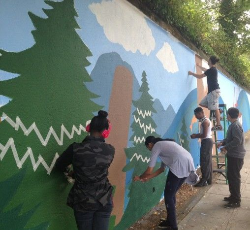 Putting final touches on the mural.