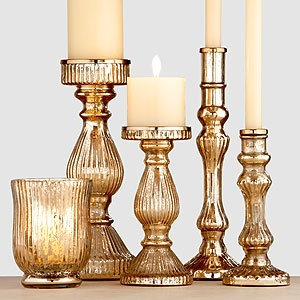 Lisa: gold mercury glass candleholders $10-17 {antique gold has been growing on me lately...would look great with the golden maize paint color in the basement}