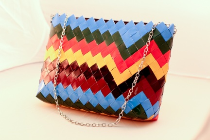 Stripes that zig-zag across the designer candy wrapper handbag to create a fashionable look.  And yet we found a spot for your photos.  The cutting edge fashion multi-colors go with just about anything.  Great for spring or summer.  Size 13″ x 9-1/2″ x 3″ with zipper and silver chain.  Plus we included an attached cloth inner bag to help keep you organized.  Order with the zig-zag pattern or personalize with your own pictures!  $90.00