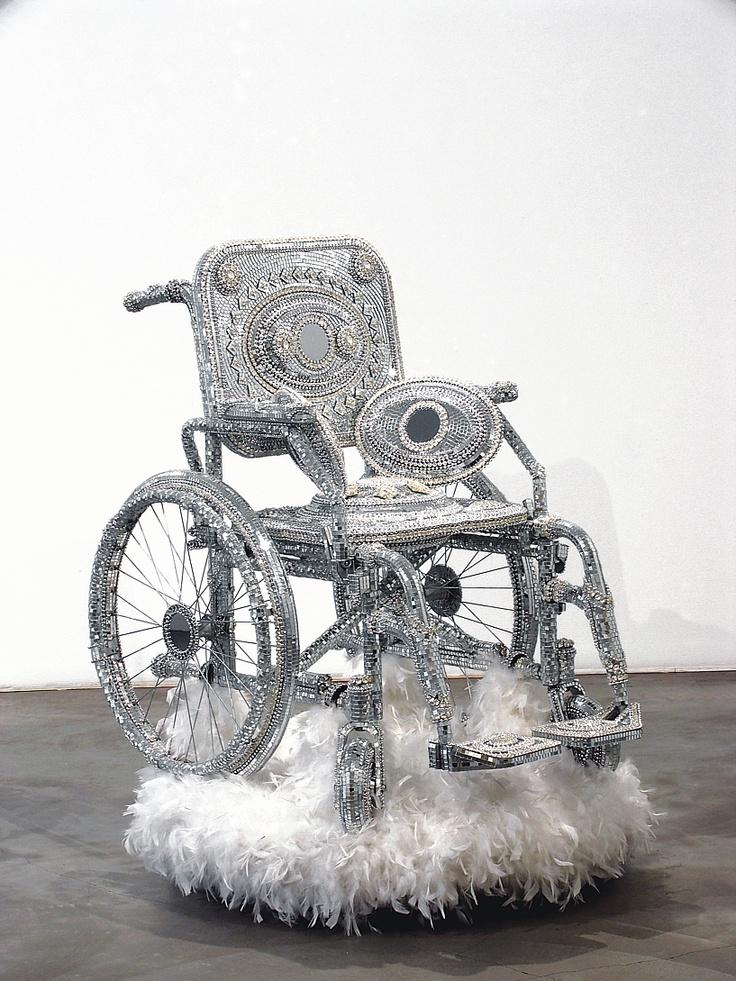 "Kristian Kozul, ""Wheelchair,"" 2003, wheelchair, mirrors, rhinestones, feathers, turntable"