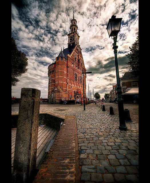 """Hoofdtoren Hoorn, Holland. I have an oil painting of the sea side of this toren.  Also a Delft plate by """"Fles"""" and a silver spoon each with the Hooftoren."""