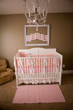I LOVE picture frame on top of crib. I think the room