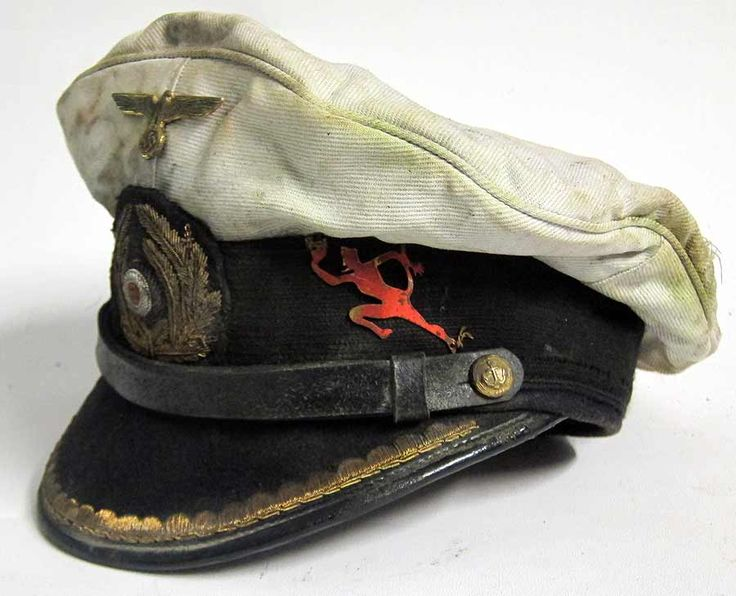 U-552 Erich Topp U-Boat Cap Red Devil Reproduction German U-Boat Submarine Captains Peaked cap with 70+ years of ageing and numerous oil stains and some worn and tarnished areas as worn by the Captain of U-552 Erich Topp.  www.warhats.com