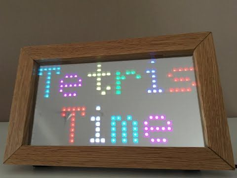 I built this Tetris style timepiece with a P10 RGB matrix