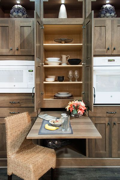 We love this hideaway table for small-space kitchens! Hidden behind a drawer front in this pantry-style cabinet is a small slide-out table, the perfect solution for a space-starved kitchen in need of an extra spot for meals—or meal prep. From @wellborncabinet