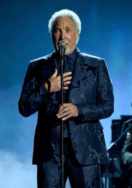 Tom Jones Photos Photos - Singer Tom Jones performs onstage at the 25th anniversary MusiCares 2015 Person Of The Year Gala honoring Bob Dylan at the Los Angeles Convention Center on February 6, 2015 in Los Angeles, California. The annual benefit raises critical funds for MusiCares' Emergency Financial Assistance and Addiction Recovery programs. For more information visit musicares.org. - MusiCares Person Of The Year Tribute To Bob Dylan - Roaming Show