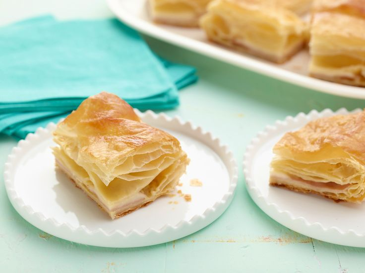 Get this all-star, easy-to-follow Ham and Cheese in Puff Pastry recipe from Ina Garten