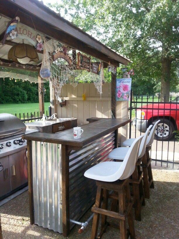 Outdoor tiki bar with homemade bar stools