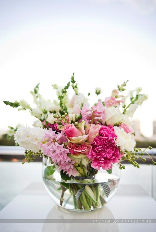 Light and dark pink flowers with white and green... I just love the clear vase with them!