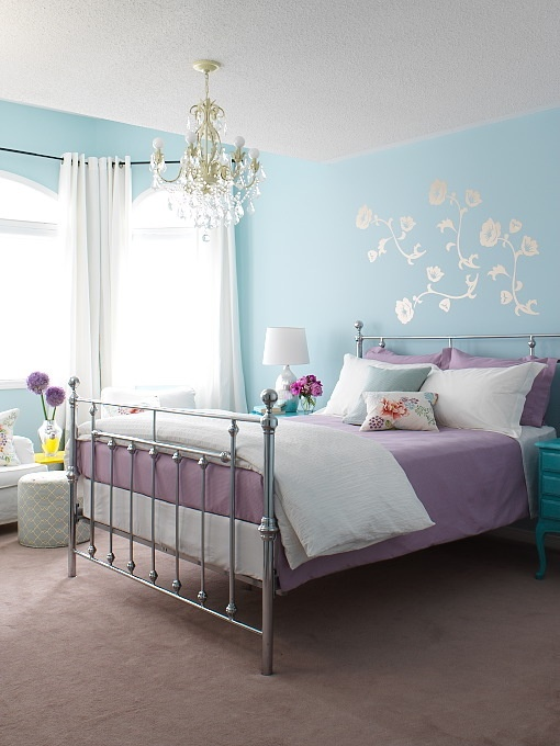 Aqua and purple.  Loving the chandelier, the bed frame, and the dark teal nightstand.