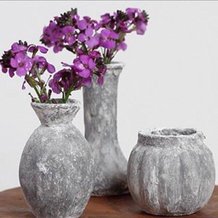 Geef oude decoratie een 'betonnen look' met muurvuller van de Action. Klik op de bron voor een video.