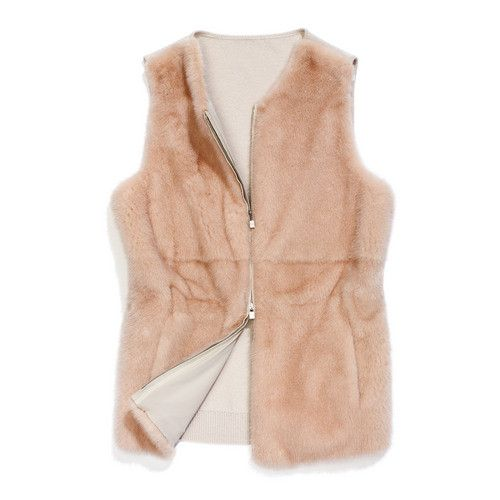 Vest in mink fur with back in knitted baby cashmere. Below hip length with a fitted cut. A refined, very versatile piece that is easy to dress up or down. Perfect in the city at the start of the season.