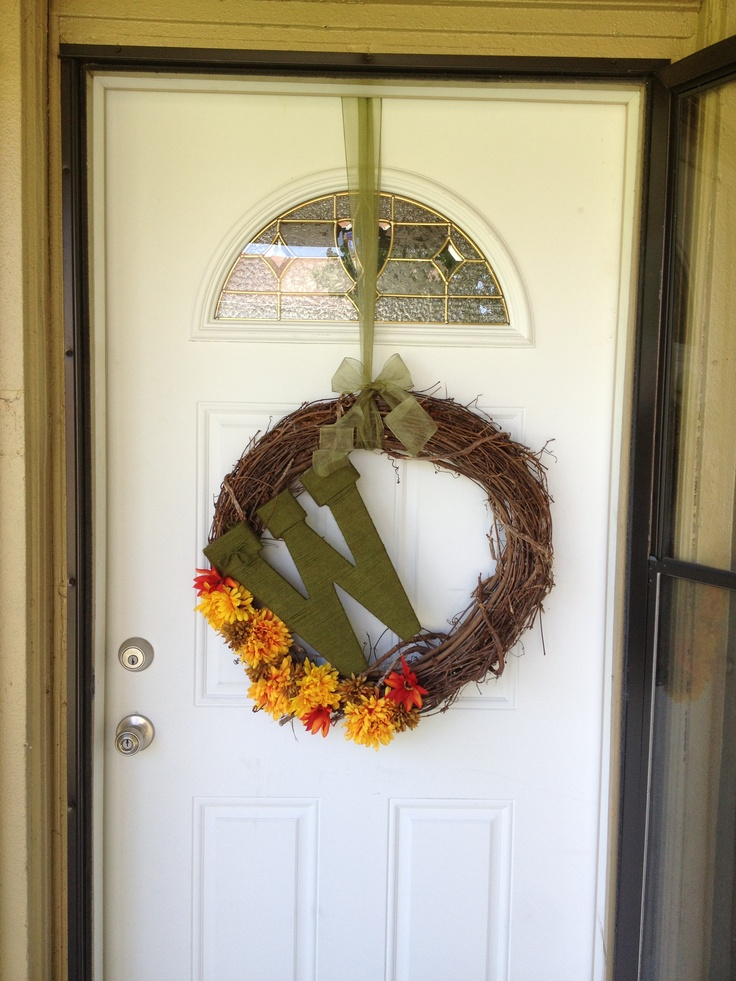 My first fall wreath!! Made it last night using a grapevine wreath, some fall florals, and a cardboard letter all from hobby lobby! About 15 dollars in all. :)