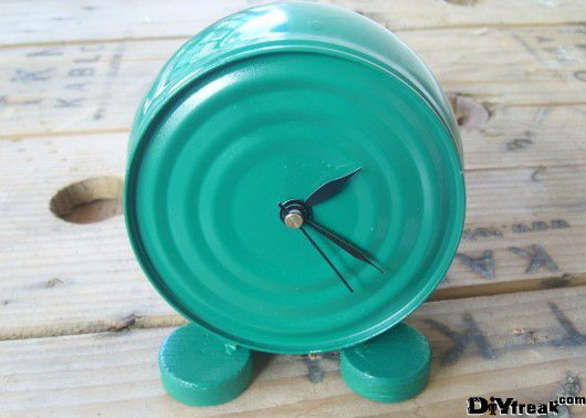 Attach a couple wooden legs to the sides of a can, paint the jar and legs in color of your choice, insert a clock mechanism inside the can, and voila!