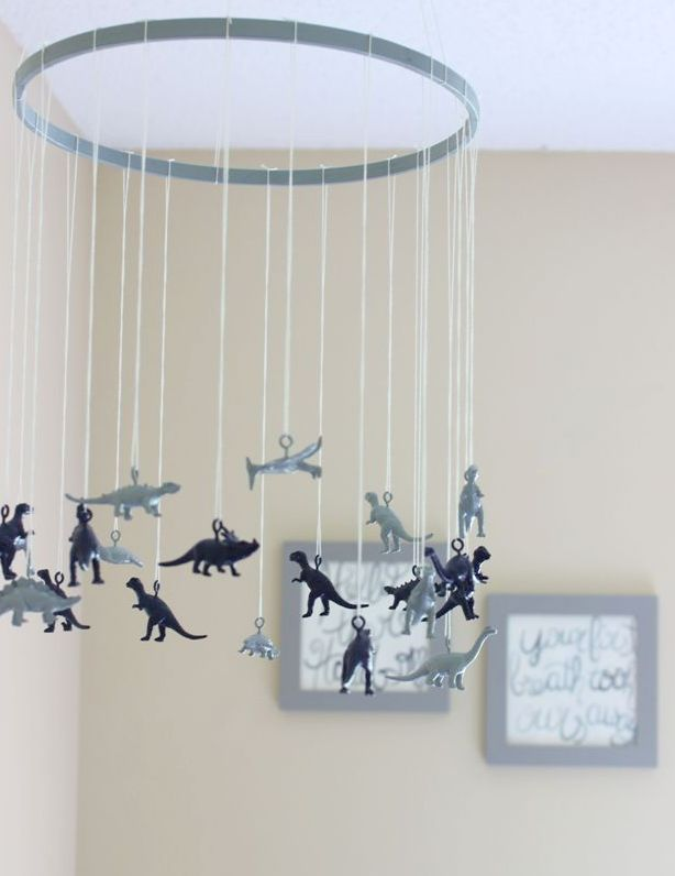 This was a DIY.  Looks like 'o' screws put into plastic dinosaurs backs, then spray painted and hung in a staggered manner. Cute!