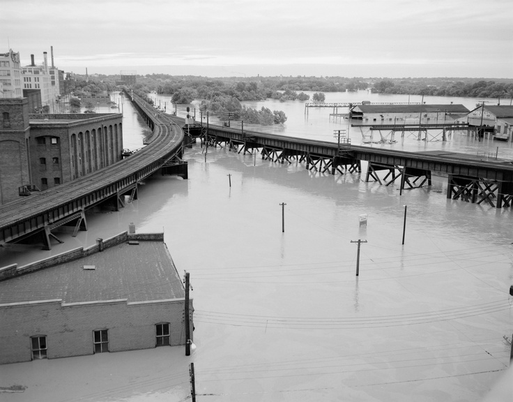 View of flooding in Richmond from the I-95 bridge. 6/23/1972. No. 72-957, Virginia Governor's Negative Collection, Library of Virginia.