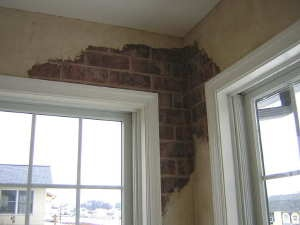 Broken Plaster over Faux Brick