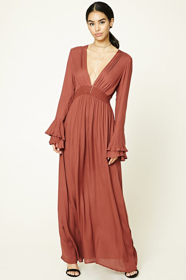 A textured woven maxi dress featuring a plunging V-neckline, smocked waist, long flounce-layered sleeves, and a mini skirt underlayer.