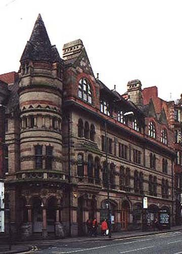 """Nottingham Express Offices, Upper Parliament Street, Nottingham. These are the newspaper offices, printing works, shops and offices for Messrs. Jevons and Renals, proprietors of the """"Nottingham Express"""" newspaper. Fothergill built them in 1875-76, the corner entrance tower being inspired by the work of the architect Burges. The upper storey was added by Fothergill in 1898-99 to provide the paper with more office space. Graham Greene worked in this building in his youth as a """"cub-reporter""""."""