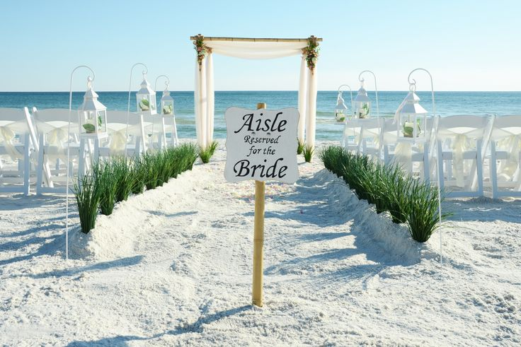 "Bamboo beach wedding arbor with hanging lantern decoration. Custom ""Aisle Reserved for the Bride"" sign.  Seacrest Beach, Florida destination beach wedding."