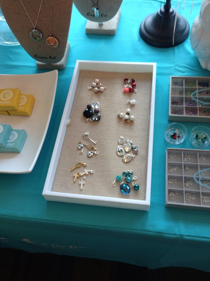group dangles together according to color, such a nice idea.  Origami Owl Jewelry Bar Setup Ideas - Find White Square display bowls, linen trays, table clothes and everything you need for your Origami Owl jewelry bar display all in one place - http://astore.amazon.com/owlbar-20