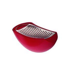 """Alessi Parmenide Grater - Red by Alessi. $21.00. Designed by Alejandro Ruiz. Grater and serving bowl in one. Also available in Ivory. Grater in steel with parmesan cheese cellar. h 2.9"""" w 5.9"""" dia 2.6"""". A giant in the world of contemporary product design, Alessi is a family run Italian business founded in 1921 that describes itself as a worldwide ambassador of Italian design. Alessi is famous for its playful design of affordable objects and appliances for the kit..."""