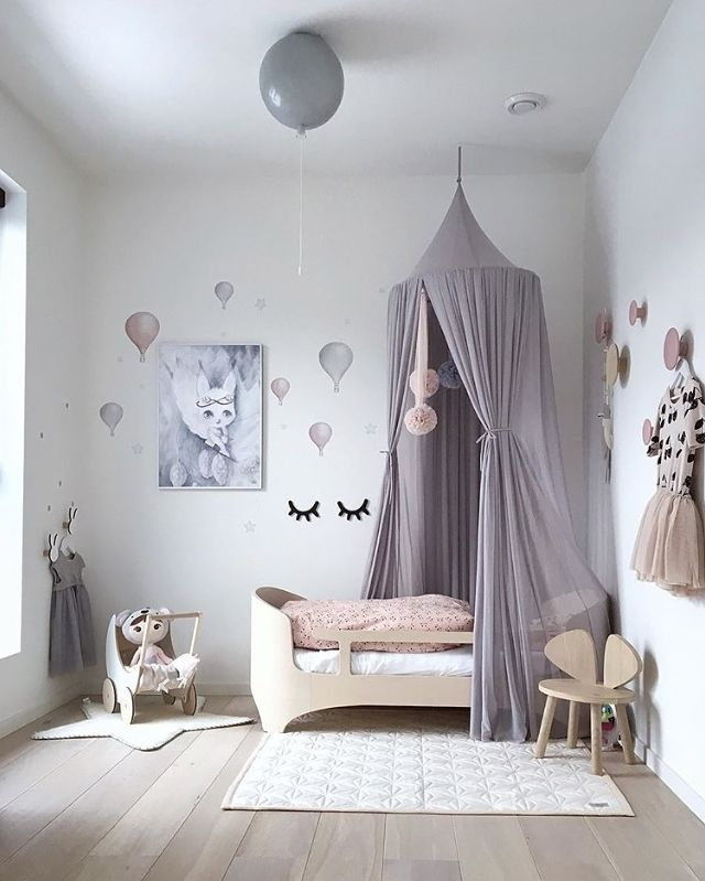 What a lovely little girl's room! Ooh Noo Toy Pram available online.