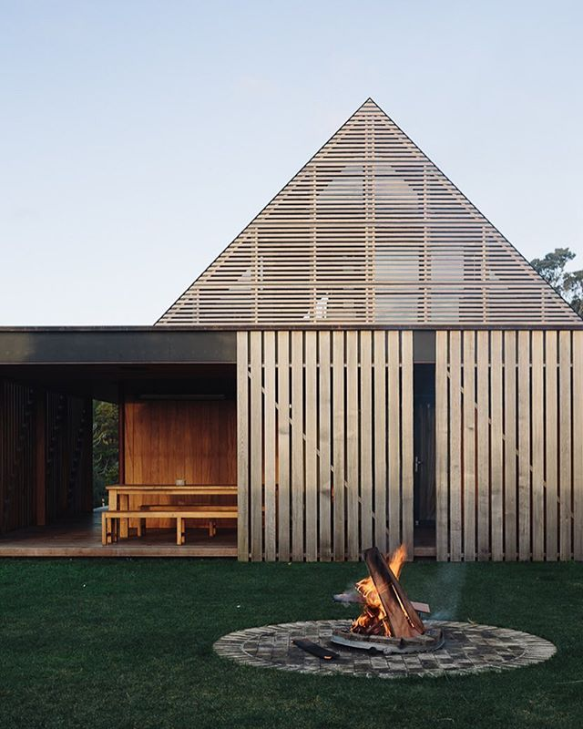 The fire pit in the courtyard of a new Auckland home by @fearonhay that stars in our new issue. Sliding screens modulate wind and sun to a simple outdoor seating area that works in winter or summer.  @simon.c.wilson Shoot produced by @ameliajholmes. More in our new issue and on homemagazine.co.nz #architecture #fearonhay