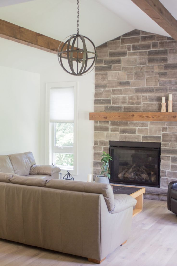 Modern rustic, stone fireplace, wood mantle, beams, oak floors, light floors