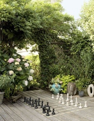 Outdoor Chess game use oversized chess pieces and chalk on your deck!  http://thegardeningcook.com/outdoor-games/