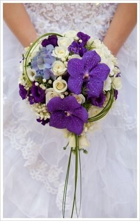 Modern grouped bouquet with vibrant vanda orchids, roses and loops of grass...a unique design!