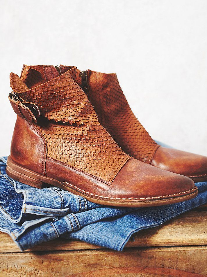 Every needs a pair of brown ankle boots in their life. These leather boots are perfect. Love the patterned detail on top.