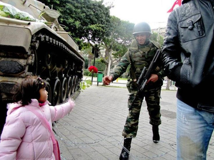 """After the army refused orders to fire on innocent protesters, this little Tunisian girl handed one soldier a rose and told him that it would """"defend the revolution."""" [Tunisian Revolution, 2011]"""