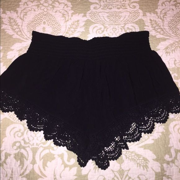 Black crocheted shorts Worn once. Great condition. Size large but fit like a small. Pre-shrunk. Stretchy material, meant to fit loose. Super cute. Shorts