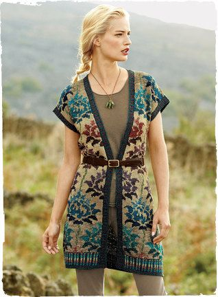 A fabulous statement piece, blooming with lotus flowers from 14th century Central Asian tilework. Handknit in rich jewel tones on a tweeded ombré ground, this pima art knit is a versatile layer with a buttonless placket, dropped shoulders and plaited rib trim.
