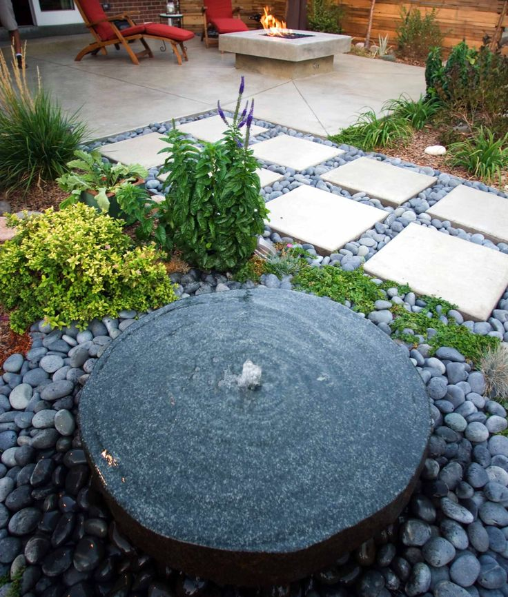 The round water feature and the squares of pavers balance each other nicely