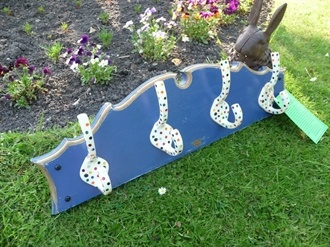 Blue coat rack with Polka Dot hooks , hooked on hooks