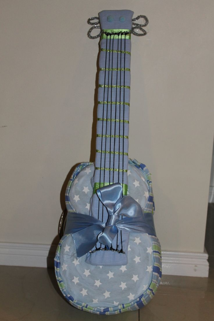 First Go at a Nappy Guitar! Our new nephew is bound to be a Mik Mak in no time
