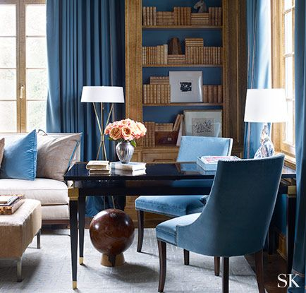Blue is chic and sophisticated in Suzanne Kasler's interior. The soft texture in the fabric and rich  gold accents provide a welcome warmth.