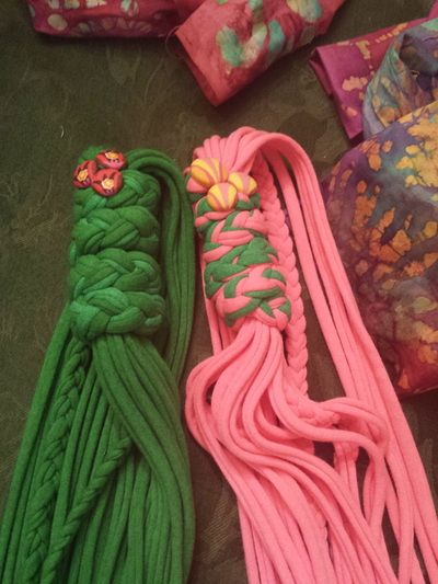 pink and green t-shirt scarves with fabric covered buttons
