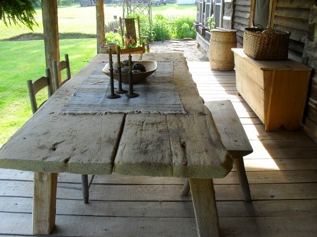 .Love the old farmhouse porch and this very old and worn farm table.....j