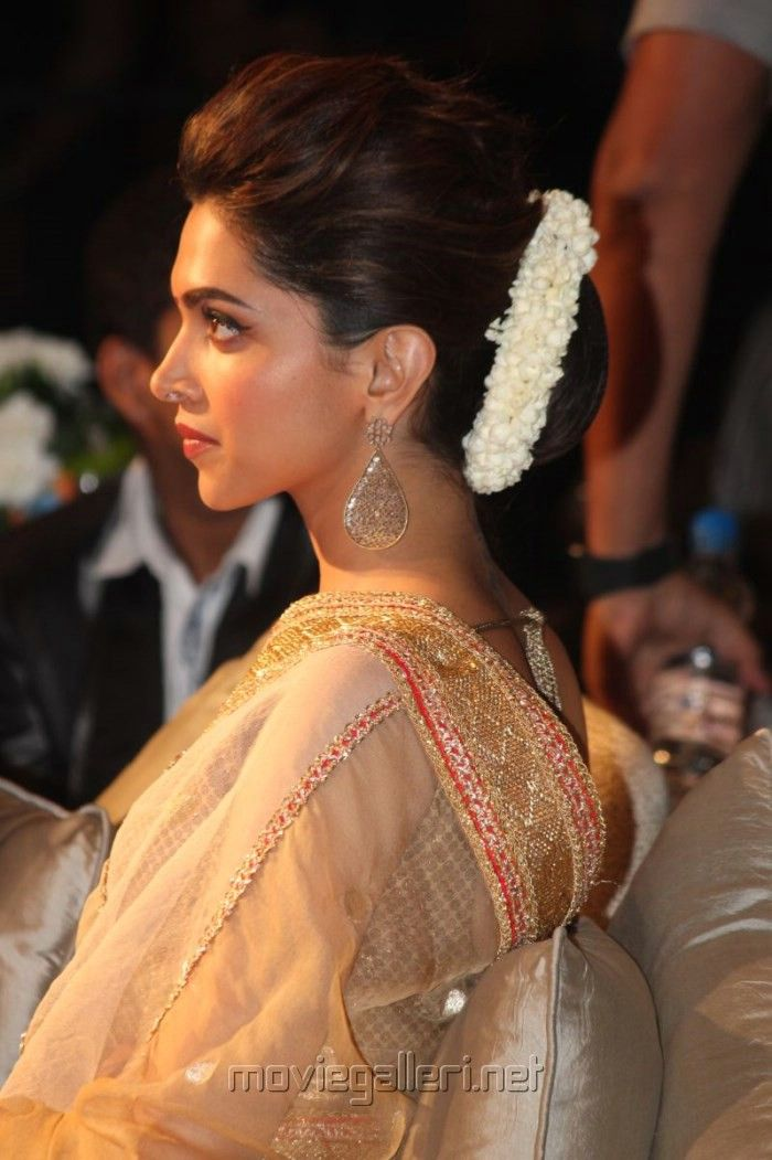Deepika Padukone, with a beutiful low bun and a neatly made gajra. Care however should be taken before adopting such hairstyles, as due to it's high static charge, it will cause phlegm to move up in the throat, causing the voice to quaver & a frequent urge to clear the throat. A heavy chabi chhalla with a long & wide hook if inserted at the edge of the pleats of the saree, will reduce this problem as it's hook will activate the acupressure points that act to keep the throat clear.