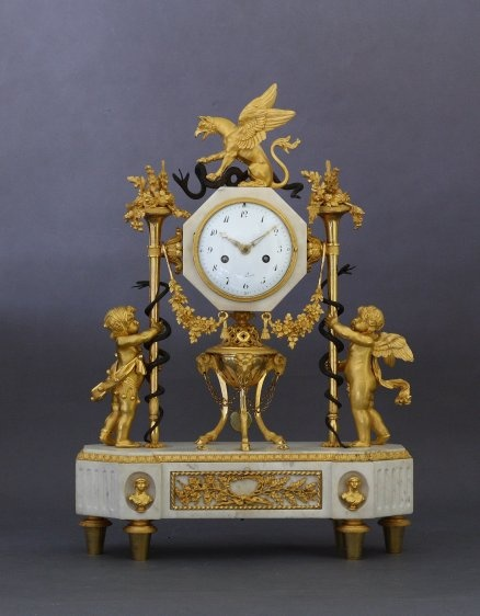 French Louis XVI (circa 1785) ormolu, patinated bronze and white marble clock.