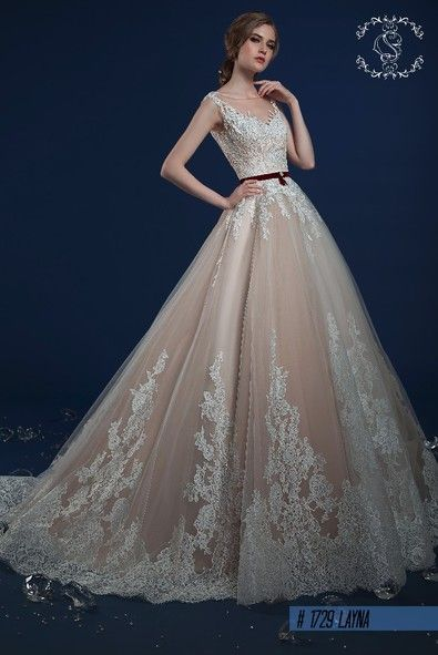 Wedding dress in Victorian style with the detailed lace at the bottom and back of the dress info@michelangela.co.za