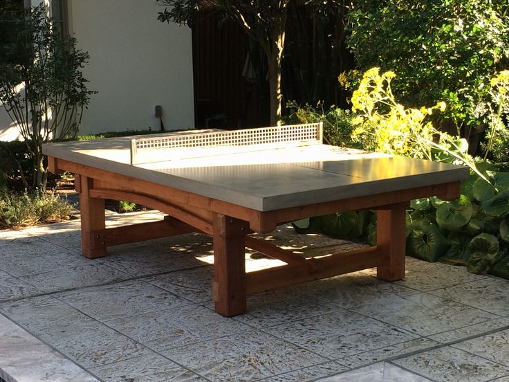 This one of a kind outdoor ping pong table was a custom request from the Otness Family. They really wanted a cohesive look to match the custom playhouse we made in the Spring. I used spare parts from their playset build and created this fantastic redwood base for a concrete ping pong table top.