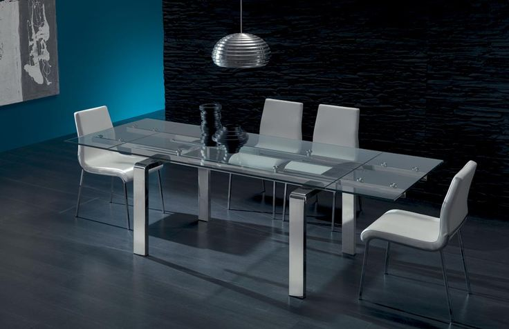 SHADOW. Shadow represents the living area with an idea of lightness and rigorous elegance. Extending dining table with chromed legs, glass top and visible extensions under the top, running metal mechanism.    http://www.easy-line.it