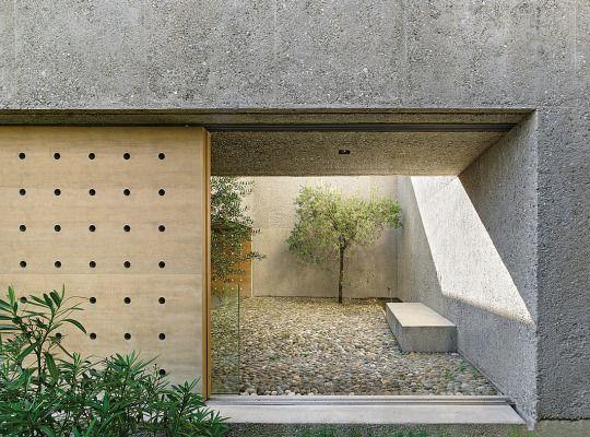 House patio in Brissago by Wespi de Meuron Romeo architects | Lago Maggiore and the Swiss Alps.