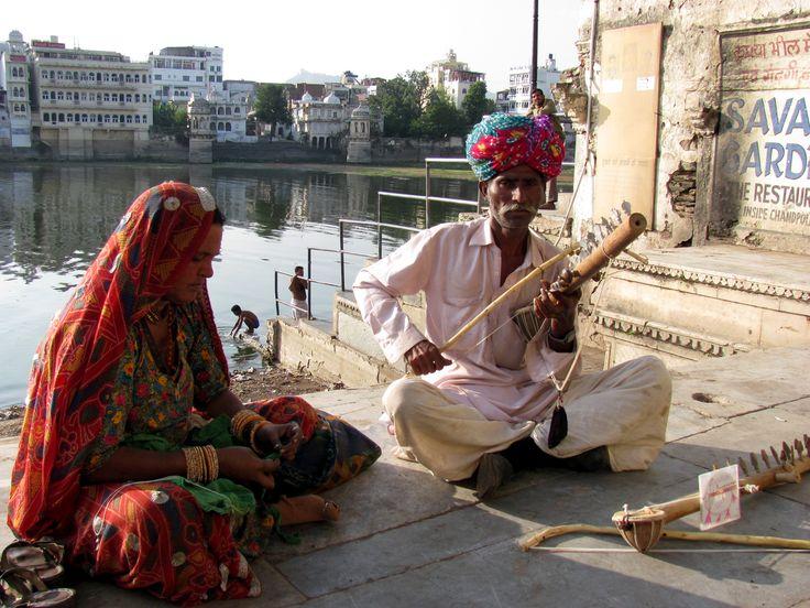 Street musician jamming on the desert fiddle.